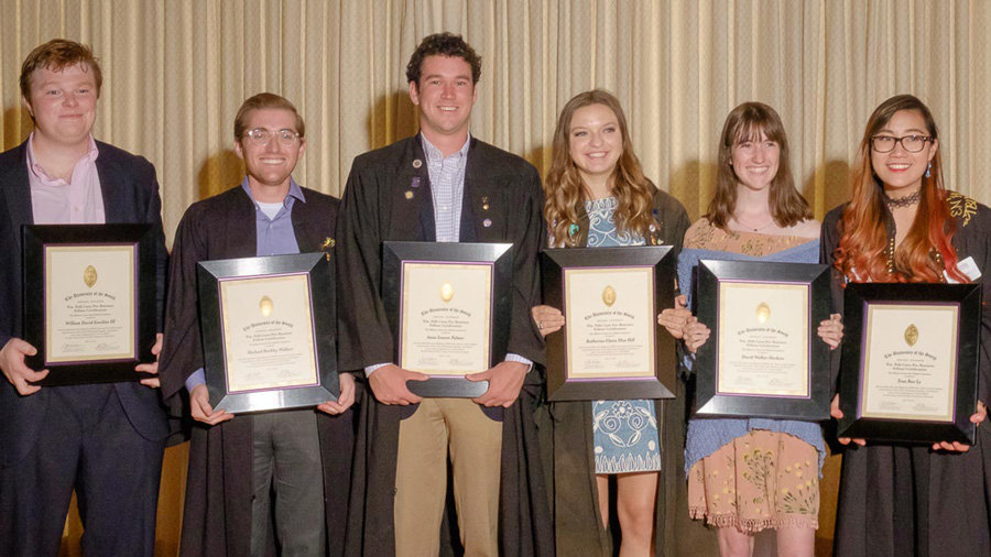 Photo of six Carey grads with certificates
