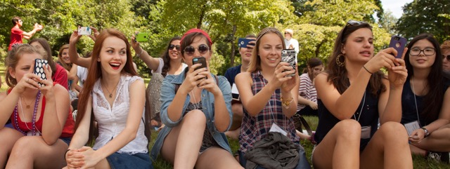 SYWC Girls with phones at 4th of July