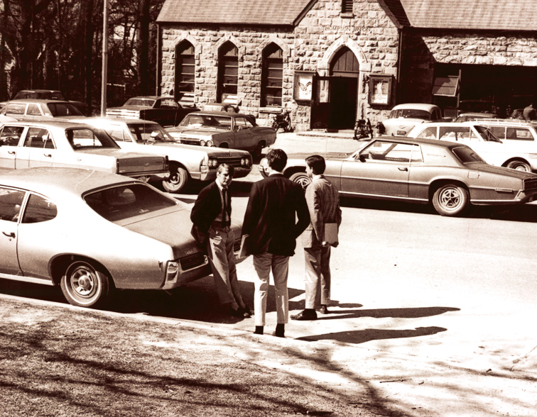 Historic photo of Thompson Union with cars parked out front
